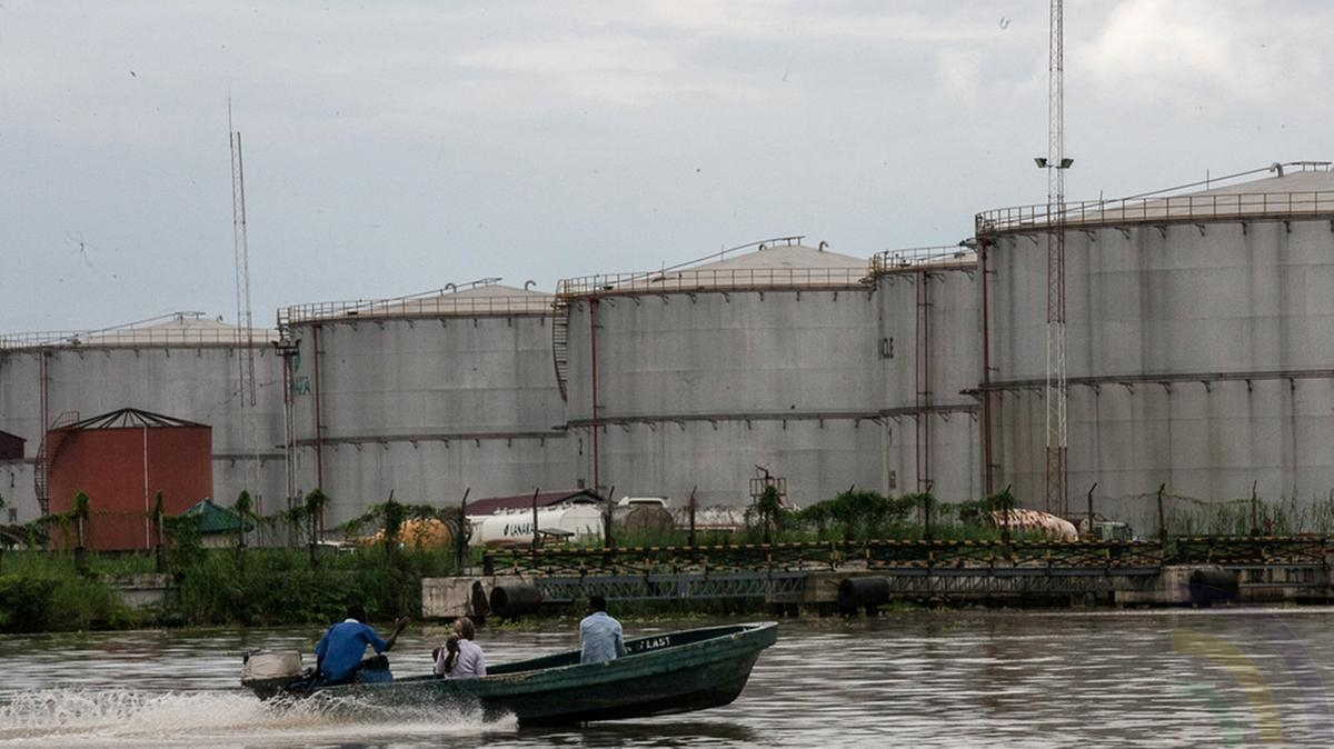 CAPTION - Nigeria Oil Company - The oil city of Warri, in Delta state, Nigeria. The government is to investigate alleged spending. PHOTO CRED; Reuters