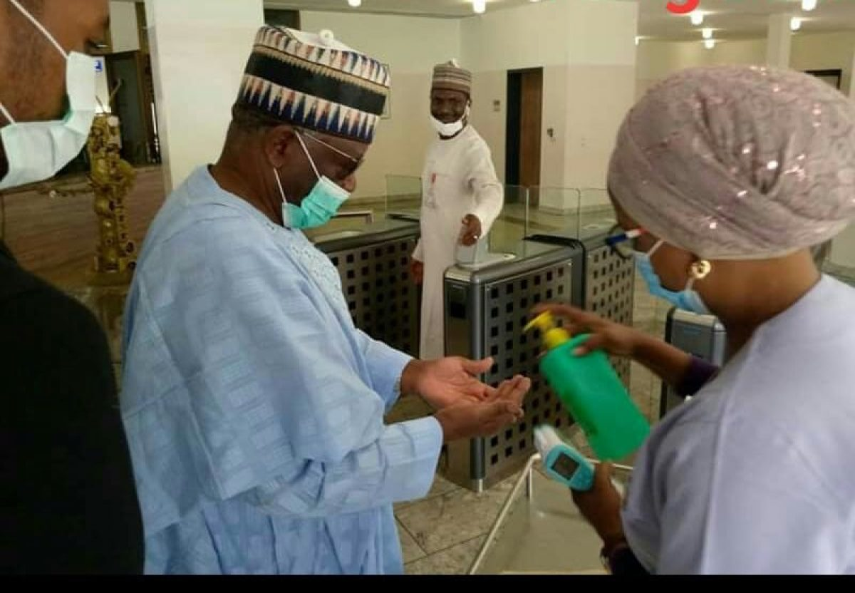 Professor Agboola Gambari being given Hand Sanitizer during his Visit to the Presidential Villa, Abuja - The New Chief of STaff to the President