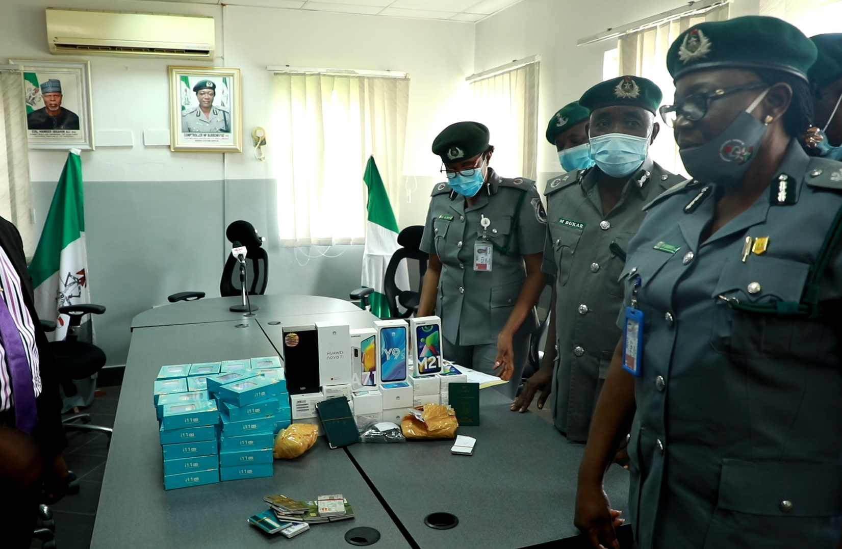 Few days after thousands of ATMs and sim cards were intercepted by officers of the Nigeria customs service at the Lagos international airport; officers of the Nigeria customs at the Abuja airport have again arrested two travelers carrying dozens of ATMs among other items.